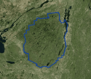 Satellite view of the Adirondacks with blue line superimposed courtesy Adirondack Wild