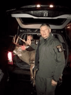 ECO Tabor with buck taken illegally with bait