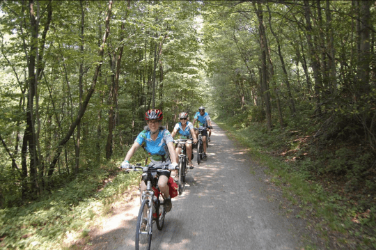bikers on the Virginia Creeper Rail Trail in the Blue Ridge Mountains of western Virginia by Richard Smith