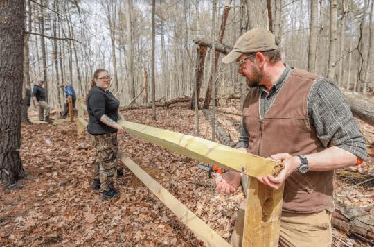 Student Veterans build split rail fence
