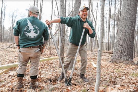 Student Veterans digging post holes