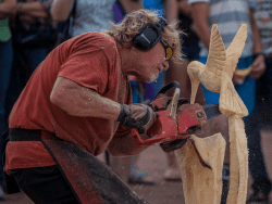 chainsaw sculpture demonstration provided by ROOST