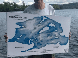 Andy Coney holding Uncle Andy's Famous Waterproof Shoal Map