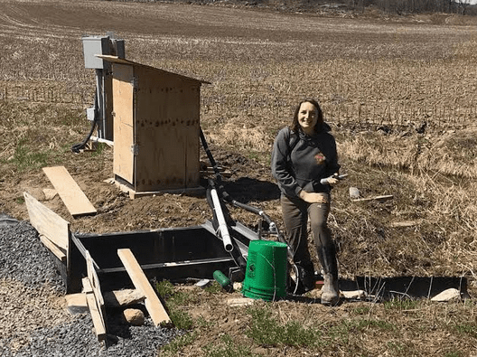 Leanna Thalmann collecting water samples at a farm in northeastern NY