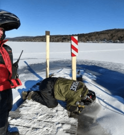 ECOs and Forest Rangers mark potentially hazardous obstacles to snowmobile traffic on Great Sacandaga Lake