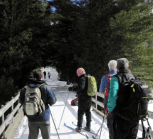 skiiers at santanoni