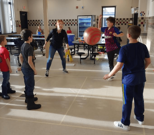 Kids playing 4-Square indoors
