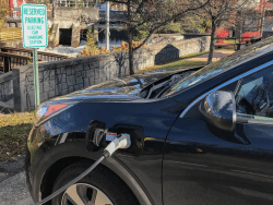 electric car charges at a downtown Saranac Lake EV charging station provided by ANCA