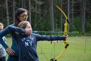 girl holding an archery bow
