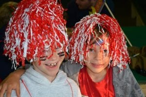 kids with pompoms on their heads