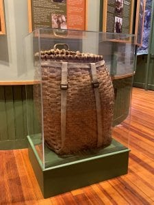 pack basket of jim goodwin on display in the hiking exhibit of the adk history museum