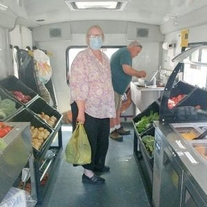 woman shopping inside of mobile market truck